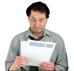 Image of a man receiving an enforcement order
